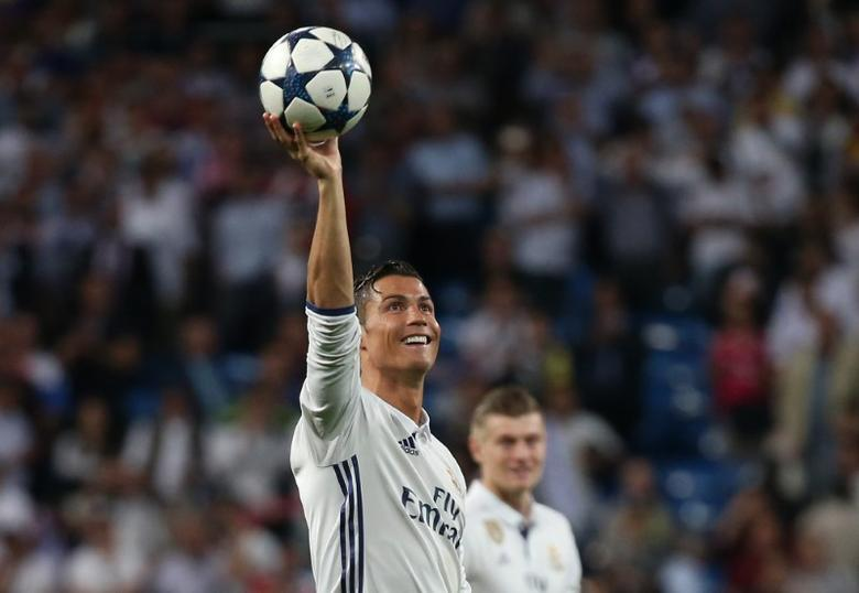 Football Soccer - Real Madrid v Bayern Munich - UEFA Champions League Quarter Final Second Leg - Estadio Santiago Bernabeu, Madrid, Spain - 18/4/17 Real Madrid's Cristiano Ronaldo celebrates after the game with the match ball after scoring a hat trick Reuters / Sergio Perez Livepic