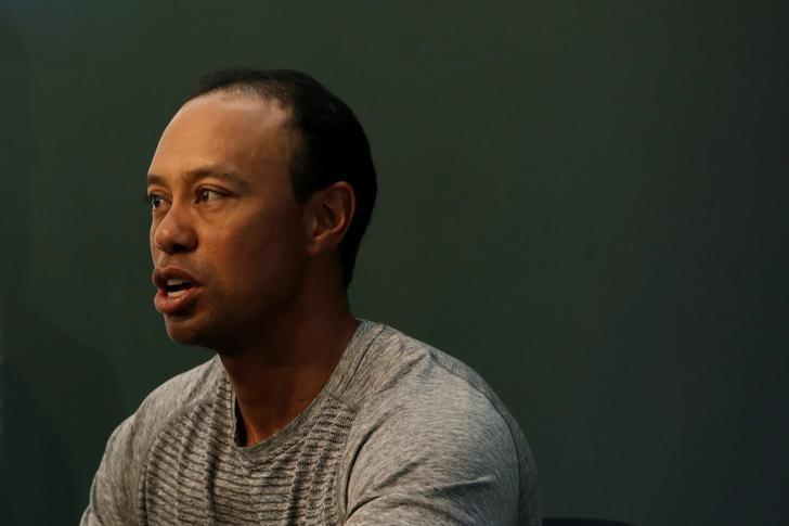 Golfer Tiger Woods speaks as he sits down to sign copies of his new book ''The 1997 Masters: My Story'' at a book signing event at a Barnes & Noble store in New York City, New York, U.S., March 20, 2017. REUTERS/Mike Segar