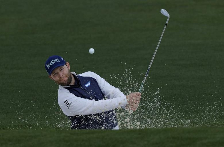 Branden Grace of South Africa hits from a bunker on the second green in first round play during the 2017 Masters golf tournament at Augusta National Golf Club in Augusta, Georgia, U.S., April 6, 2017. REUTERS/Jonathan Ernst