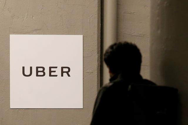 FILE PHOTO -  A man arrives at the Uber offices in Queens, New York, U.S., February 2, 2017.  REUTERS/Brendan McDermid/File Photo