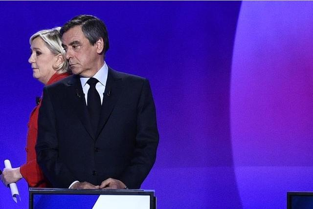 Francois Fillon, member of the Republicans political party and 2017 presidential election candidate of the French centre-right (R), and Marine Le Pen, French National Front (FN) political party leader and candidate, attend the France 2 television special prime time political show, ''15min to Convince'' in Saint-Cloud, near Paris, France, April 20, 2017.  REUTERS/Martin Bureau/Pool