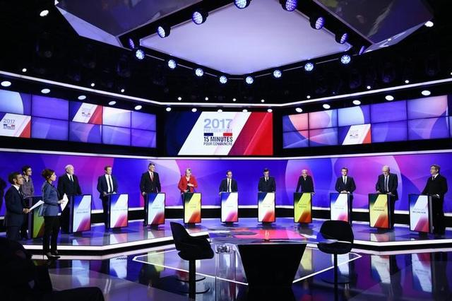 The eleven French presidential election candidates take part in a special political television show entitled ''15min to Convince'' at the studios of French Television channel France 2 in Saint-Cloud, near Paris, April 20, 2017.  REUTERS/Martin Bureau/Pool