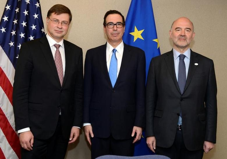 U.S. Treasury Secretary Steven Mnuchin (C) poses with Vice President for the Euro and Social Dialogue Valdis Dombrovskis (L) and European Commissioner for Economics and Financial Affairs, Taxation and Customs Pierre Moscovici prior to a meeting as part of the IMF and World Bank's 2017 Annual Spring Meetings, in Washington, U.S., April 20, 2017.   REUTERS/Mike Theiler
