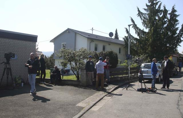 Media gather near a house were the German police arrested a man who is suspected of planting explosives targeting the bus of soccer team Borussia Dortmund is pictured in the town Rottenburg, Germany April 21, 2017. REUTERS/Michael Dalder