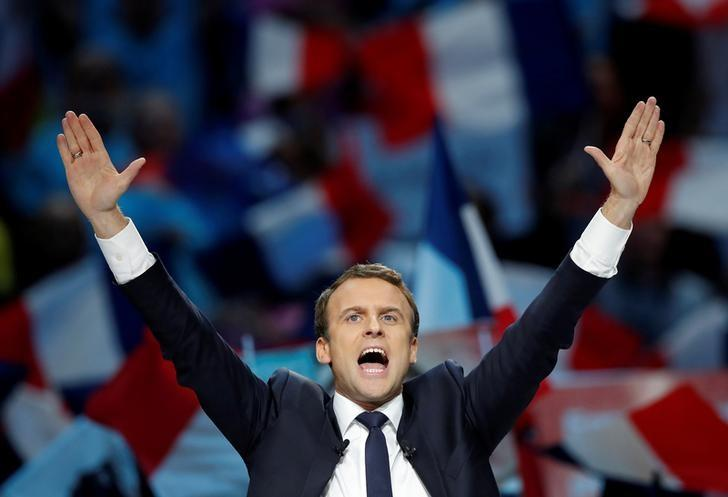 Emmanuel Macron, head of the political movement En Marche !, or Onwards !, and candidate for the 2017 French presidential election, attends a campaign political rally in Paris, France, April 17, 2017. REUTERS/Christian Hartmann