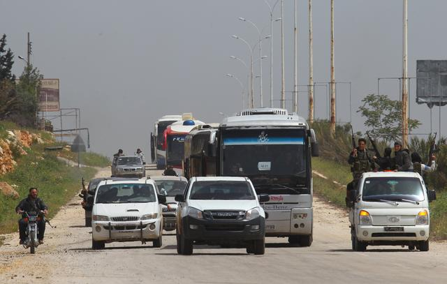 A convoy of buses carrying Sunni rebels and civilians, who were evacuated from Zabadani and Madaya, as part of a reciprocal evacuation deal for four besieged towns, travels towards rebel-held Idlib, Syria April 21, 2017. REUTERS/Ammar Abdullah
