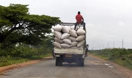 A man rides atop a truck ferrying bags of maize to a market along a road in the outskirts of Burundi's capital Bujumbura, April 30, 2015. REUTERS/Thomas Mukoya