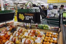 FILE PHOTO: Prices are displayed for oranges at a store in Atawapiskat, Ontario, December 17, 2011.REUTERS/Frank Gunn/Pool
