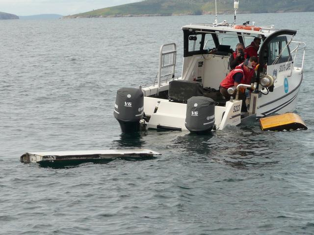 A Boeing 777 flaperon (L) cut down to match the one from flight MH370 found on Reunion island off the coast of Africa in 2015, floats after being lowered into water to discover its drift characteristics by Commonwealth Scientific and Industrial Research Organisation researchers in Tasmania, Australia, in this handout image taken March 23, 2017.   CSIRO/Handout via REUTERS