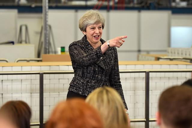 Britain's Prime Minister, Theresa May, addresses staff at a GlaxoSmithKline toothpaste factory in Maidenhead, April 21, 2017. REUTERS/Leon Neal/Pool