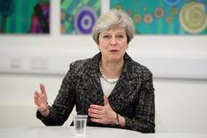 Britain's Prime Minister, Theresa May, talks to students and first-time voters at Cox Green School in Maidenhead, April 21, 2017. REUTERS/Leon Neal/Pool