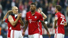 Bayern Munich's Arjen Robben and Bayern Munich's Jerome Boateng look dejected after the match  Reuters / Michaela Rehle Livepic