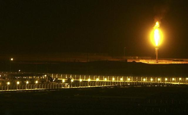 Shaybah oilfield complex is seen at night in the Rub' al-Khali desert, Saudi Arabia, November 14, 2007. REUTERS/Ali Jarekji/File Photo