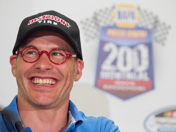 Canadian race car driver Jacques Villeneuve smiles as he speaks to the media prior to the NAPA Auto Parts 200 Nationwide Series NASCAR race in Montreal, August 18, 2011. REUTERS/Christinne Muschi/Files