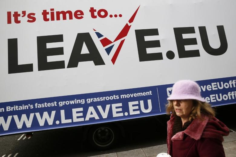 A woman walks past a Leave.EU campaign mobile advertising board in central London, Britain November 18, 2015. REUTERS/Stefan Wermuth