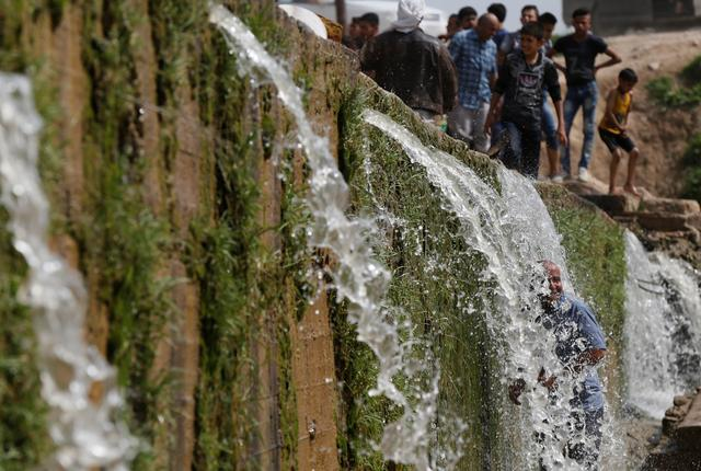 Iraqi families and youths enjoy their Friday holiday at Shallalat district (Arabic for ''waterfalls'') in eastern Mosul, Iraq, April 21, 2017. REUTERS/ Muhammad Hamed