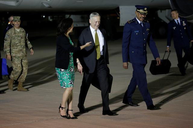 U.S. Defense Secretary James Mattis (C) is greeted by U.S. Ambassador to Qatar Dana Shell Smith (L) and Qatar Ministry of Defense Director of International Cooperation General Abdullah Jumaan al Hamad (R) as he arrives at Al Udeid Air Base in Doha, Qatar April 21, 2017. REUTERS/Jonathan Ernst