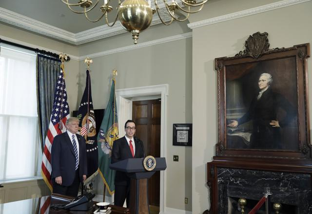 With a portrait of the first U.S. Treasury Secretary Alexander Hamilton looking on, U.S. President Donald Trump (L) arrives with Treasury Secretary Steven Mnuchin prior to signing financial services executive orders at the Treasury Department in Washington, U.S., April 21, 2017. REUTERS/Kevin Lamarque