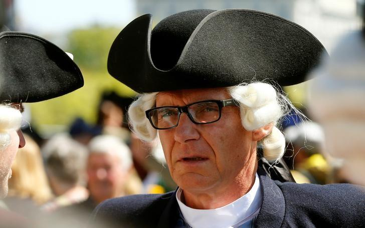 Swiss bank Credit Suisse's Chairman Urs Rohner wears a uniform of the Zunft zur Meisen guild before the traditional Sechselaeuten parade in Zurich, Switzerland April 24, 2017. Picture taken April 24, 2017.  REUTERS/Arnd Wiegmann