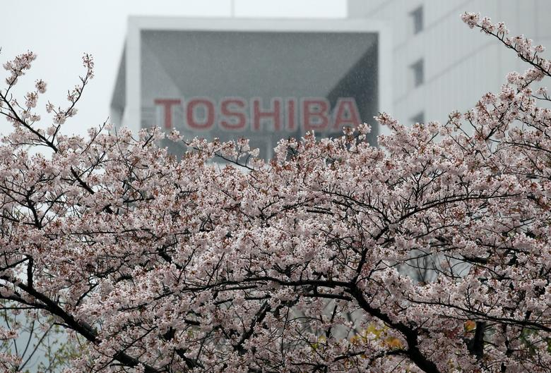 The logo of Toshiba Corp is seen behind cherry blossoms at the company's headquarters in Tokyo, Japan April 11, 2017. REUTERS/Toru Hanai