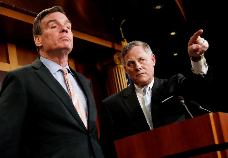 FILE PHOTO --  Senate Intelligence Committee Chairman Sen. Richard Burr (R-NC), accompanied by Senator Mark Warner (D-VA), vice chairman of the committee, speaks at a news conference to discuss their probe of Russian interference in the 2016 election on Capitol Hill in Washington, D.C., U.S., March 29, 2017.  REUTERS/Aaron P. Bernstein/File Photo
