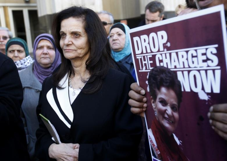 Palestinian activist Rasmieh Yousef Odeh (C) stands outside the federal courthouse after her sentencing in Detroit, Michigan March 12, 2015. REUTERS/Rebecca Cook
