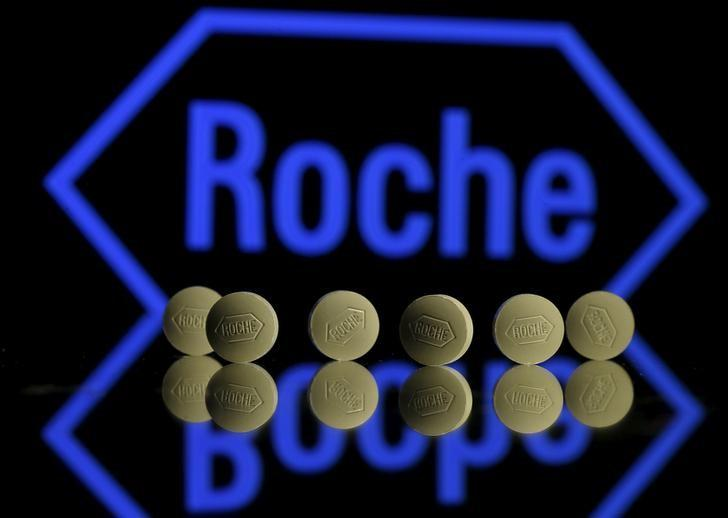Roche tablets are seen positioned in front of a displayed Roche logo in this picture illustration, January 22, 2016.  REUTERS/Dado Ruvic/Illustration/File Photo