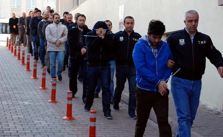 Suspected supporters of the U.S.-based cleric Fethullah Gulen are escorted by plainclothes police officers as they arrive at the police headquarters in Kayseri, Turkey, April 25, 2017. Picture taken April 25, 2017. Olcay Duzgun/Dogan News Agency/via REUTERS