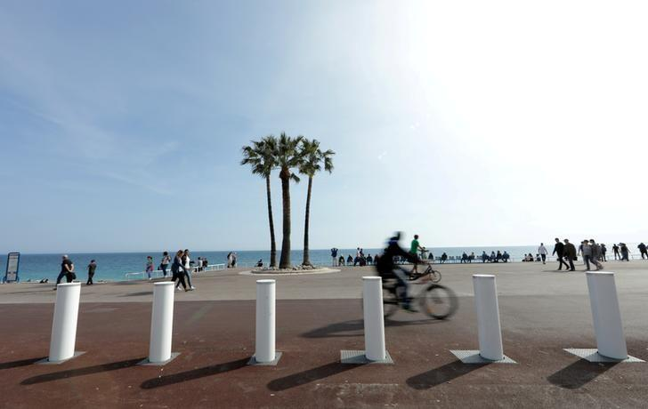 Concrete bollard barriers provide security on the Promenade des Anglais that were installed after the July 2016 truck attack, in Nice, France, April 12, 2017.   REUTERS/Eric Gaillard/File Photo