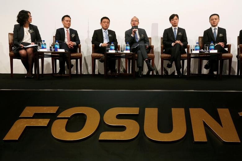 FILE PHOTO - Fosun International Ltd Chairman Guo Guangchang (4th L) speaks at a news conference in Hong Kong, China March 29, 2017.      REUTERS/Bobby Yip/File Photo
