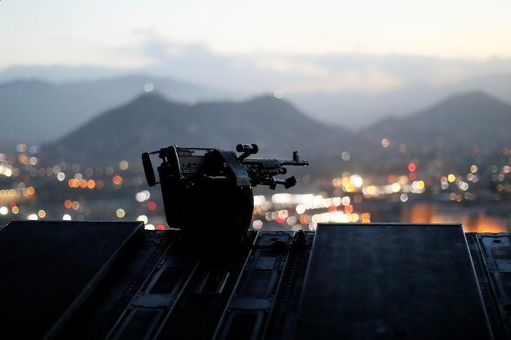 The city of Kabul can be seen at sundown from the rear deck of a U.S. Army helicopter as it departs Resolute Support headquarters with U.S. Defense Secretary James Mattis aboard in Kabul, Afghanistan April 24, 2017. REUTERS/Jonathan Ernst