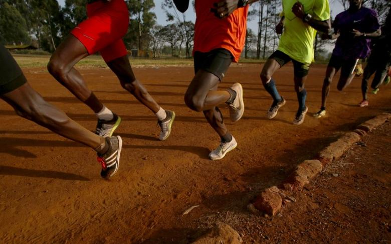 FILE PHOTO - Athletes exercise in the early morning in the sports ground of the University of Eldoret in western Kenya March 21, 2016.  REUTERS/Siegfried Modola/File Photo