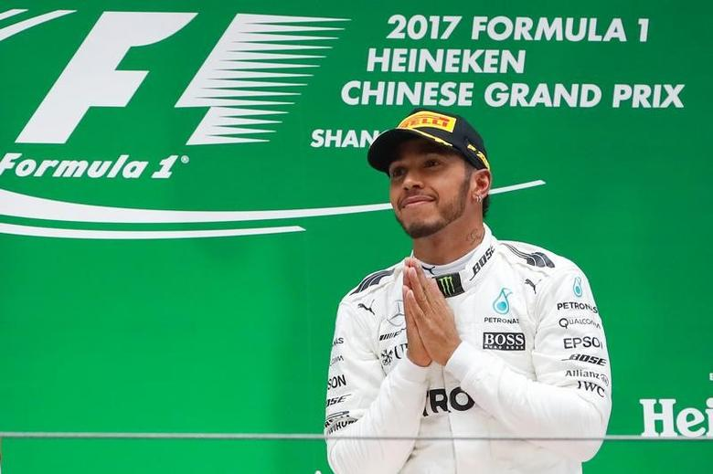 Formula One - F1 - Chinese Grand Prix - Shanghai, China - 09/04/17 - Mercedes driver Lewis Hamilton of Britain celebrates on the podium after winning the Chinese Grand Prix at the Shanghai International Circuit. REUTERS/Aly Song/Files
