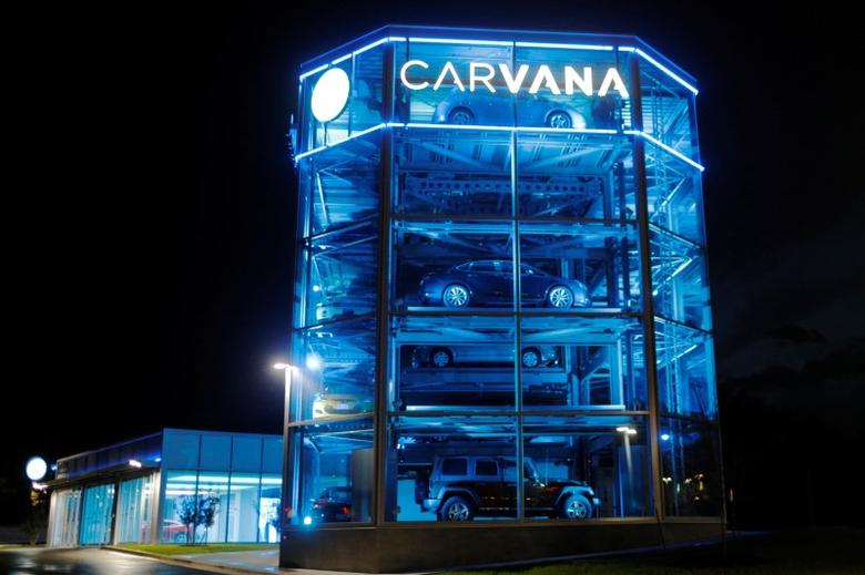 Vehicles are displayed at a Carvana dealership, which allows customers to buy a used car online and have it delivered or pick it up from an automated-tower, in Austin, Texas, U.S., March 9, 2017. Picture taken March 9, 2017. REUTERS/Brian Snyder