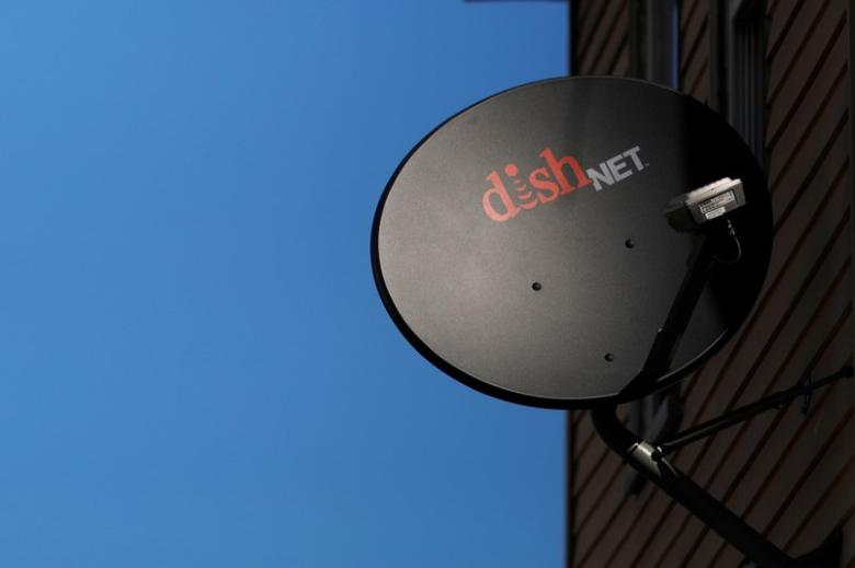 FILE PHOTO: A Dish Network receiver hangs on a house in Somerville, Massachusetts, U.S., February 21, 2017.   REUTERS/Brian Snyder