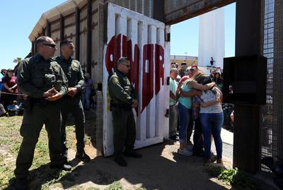 Reunited for three minutes at Mexico-U.S. border