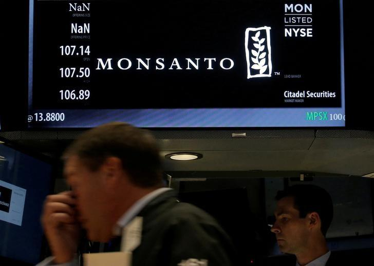 A trader works at the post where Monsanto Co. is traded on the floor of the New York Stock Exchange (NYSE) in New York City, U.S., August 25, 2016. REUTERS/Brendan McDermid/File Photo
