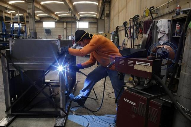 A worker welds a metal furnace in a factory in Gravellona Lomellina, 45km (27 miles) southwest of Milan, June 11, 2013. REUTERS/Stefano Rellandini/Files