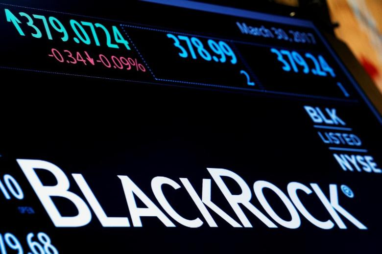 FILE PHOTO --  The company logo and trading information for BlackRock is displayed on a screen on the floor of the New York Stock Exchange (NYSE) in New York, U.S., March 30, 2017. REUTERS/Brendan McDermid/File Photo