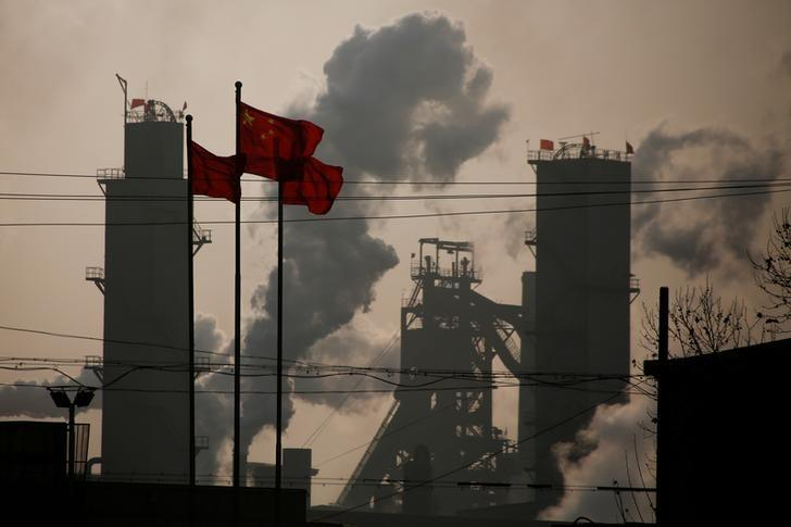 Chinese national flags are flying near a steel factory in Wu'an, Hebei province, China, February 23, 2017. REUTERS/Thomas Peter/Files