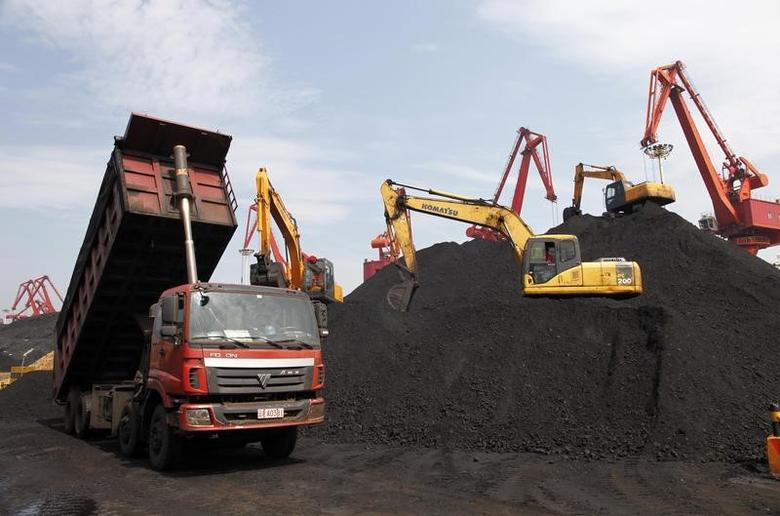 A truck unloads imported coal at a port in Lianyungang, in Jiangsu province July 15, 2013. REUTERS/China Daily