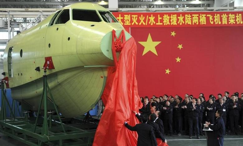 Officials of Aviation Industry Corporation of China (AVIC) unveil the newly-made nose of amphibious aircraft AG600, during a ceremony at a factory in Chengdu, Sichuan province March 17, 2015. REUTERS/China Daily/File Photo