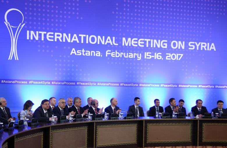 FILE PHOTO: Participants of Syria peace talks attend a meeting in Astana, Kazakhstan February 16, 2017. REUTERS/Mukhtor Kholdorbekov