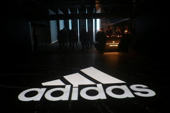 FILE PHOTO: An Adidas logo is seen at the new Futurecraft shoe unveiling event in New York City, New York, U.S. April 6, 2017. REUTERS/Joe Penney/File Photo