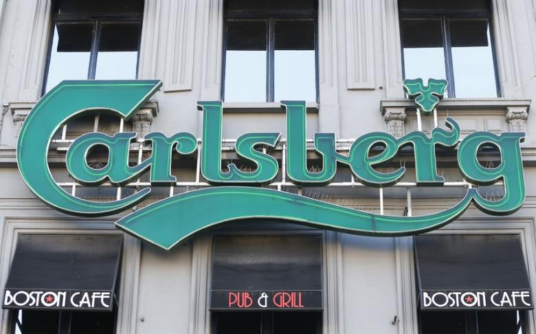 A logo of Carlsberg beer is seen on the entrance of a pub in Brussels, Belgium March 10, 2016.   REUTERS/Yves Herman