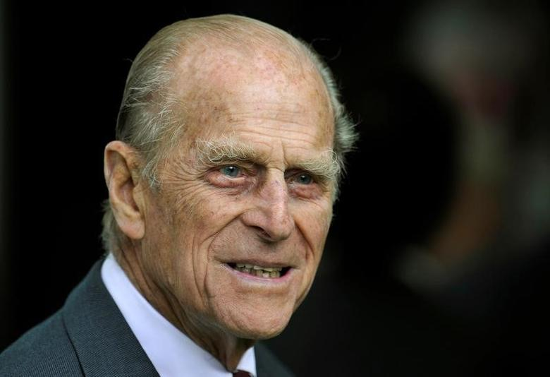 FILE PHOTO -  Britain's Prince Philip smiles during his visit with Queen Elizabeth to the Irish National Stud in Kildare, Ireland in this May 19, 2011 file photo. REUTERS/Dylan Martinez/Files