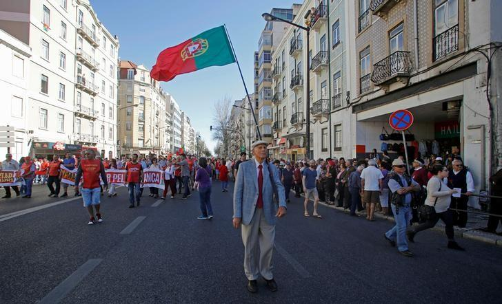 A man holds a Portuguese flag and shout slogans during a May Day march by the Portuguese union CGTP in Lisbon, Portugal, May 1, 2016. REUTERS/Hugo Correia