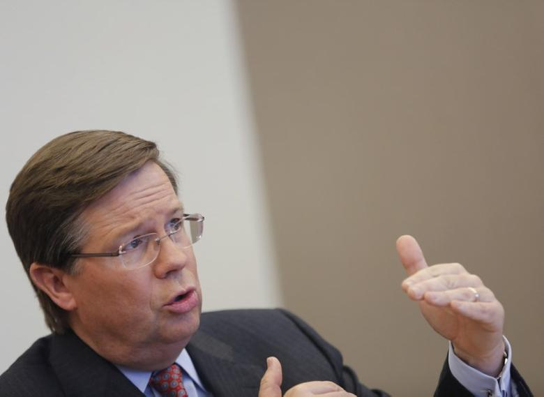 FILE PHOTO: Jim Lentz, president and CEO of Toyota Motor Sales, U.S.A. speaks during an interview in New York, March 28, 2013. REUTERS/Brendan McDermid