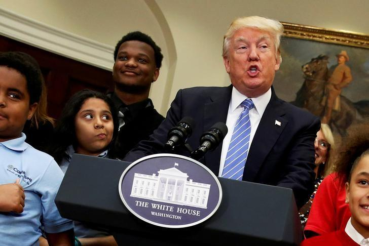 U.S. President Donald Trump is surrounded by local schoolchildren as he delivers remarks at a school choice event at the White House in Washington, U.S. May 3, 2017.  REUTERS/Jonathan Ernst