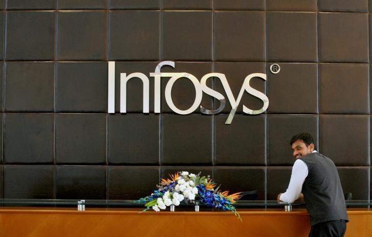 FILE PHOTO: An employee of Infosys stands at the front desk of its headquarters in Bengaluru, India, April 15, 2016.   REUTERS/Abhishek N. Chinnappa/File Photo